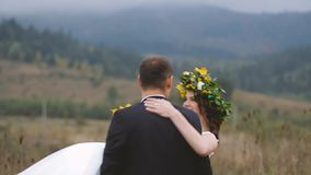 Groom Spining Around with his Wife in Hands. Mountain shot stock video footage