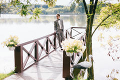 Groom standing on the river pier Royalty Free Stock Photos