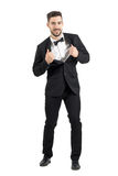 Groom stretching and pulling collar of tuxedo excited look at camera Stock Images