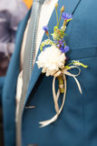 Groom. In suit with a flower Stock Image