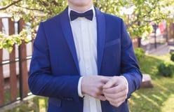 Groom in a suit. Hands wear cufflinks Stock Image
