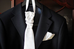 Groom suit and white tie on a hanger Royalty Free Stock Photos