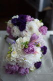 The groom in a suit or Young girl-bride or bridesmaid is holding a wedding bouquet Royalty Free Stock Photography