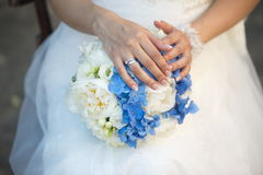The groom in a suit or Young girl-bride or bridesmaid is holding a wedding bouquet Stock Images