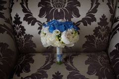 The groom in a suit or Young girl-bride or bridesmaid is holding a wedding bouquet Royalty Free Stock Images