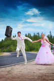 Groom with suitcase seeks for a honeymoon Royalty Free Stock Image