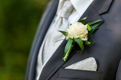 Groom suite with floral decoration stock images