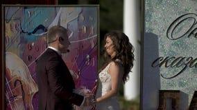 Groom swears to Bride in eternal love Couple holding hands by looking eyes to eyes stock footage