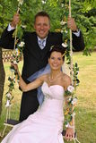 Groom swings the bride Stock Photos
