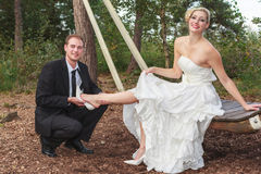 Groom takes his bride to the shoes. Stock Photography