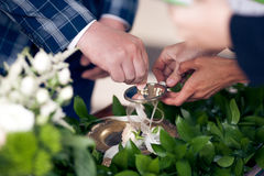 The groom takes wedding ring on ceremony Royalty Free Stock Photography