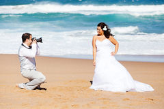 Groom taking bride's photos Royalty Free Stock Images