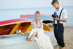 Groom taking a photo of his bride Stock Photography
