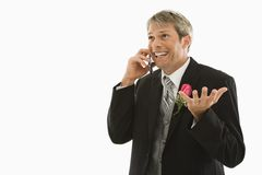 Groom talking on cellphone. Royalty Free Stock Photography