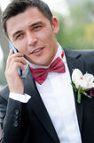 Groom talking on the phone Royalty Free Stock Photos