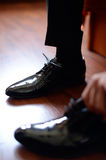 Groom teeing his shoes. Selective focus stock photo