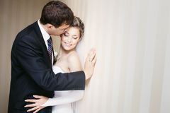 Groom tenderly kissing bride's cheek Royalty Free Stock Photo