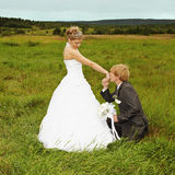 Groom to genuflect near bride Stock Images