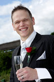 Groom Toast. A groom on his wedding day making a toast Royalty Free Stock Image