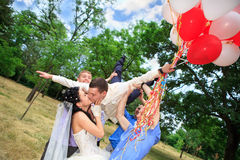 Groom tossed into air Stock Photo