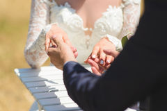Groom Touching Bride`s Fingers Stock Photography
