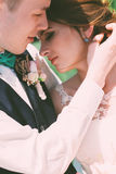 Groom touching hair of bride Royalty Free Stock Photo