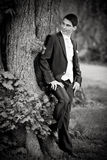Groom at tree Royalty Free Stock Photography