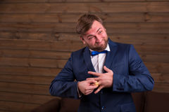 Groom trying to put on a wedding ring on finger Stock Photography