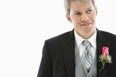 Groom in tuxedo. Portrait of Caucasian male in tuxedo with boutonniere Royalty Free Stock Photos