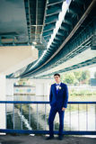 Groom under the bridge Royalty Free Stock Photography