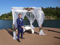 Groom under canopy. Groom before wedding ceremonial act in front of the canopy raft expected arrival of their chosen stock images