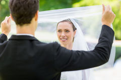 Groom unveiling his bride Stock Photography