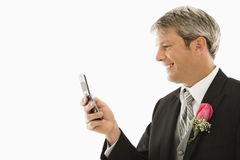 Groom using his cellphone. Stock Images