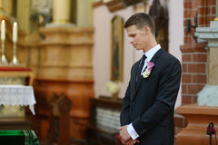 Groom waiting for the bride in church Stock Image