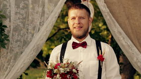 The groom is waiting for the bride HD video stock video footage
