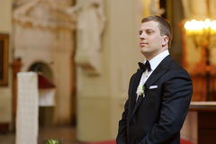 Groom waiting for the bride in church Royalty Free Stock Photography
