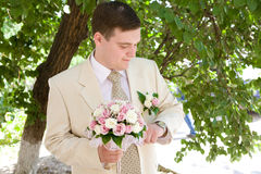 Groom with watch Stock Image