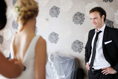 Groom watching his bride getting ready Royalty Free Stock Images