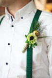 Groom wearing buttonhole Stock Photography