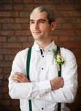 Groom wearing buttonhole with white anemone Royalty Free Stock Photos