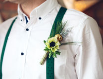 Groom wearing buttonhole with white anemone Stock Image