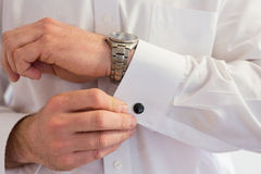 Groom Wearing Cuff Links Stock Images