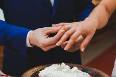 Groom wearing the Diamond ring to bride hand in Royalty Free Stock Images