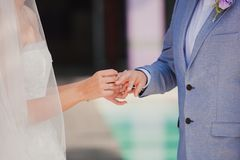 Groom wearing the Diamond ring to bride hand in Stock Images