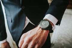 Groom wearing a new watch in the wrist. Royalty Free Stock Photos