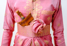 Groom Wearing a Pink Traditional Malay Songket Wedding Attire. Stock Photos