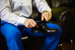 Groom wearing shoes Stock Images