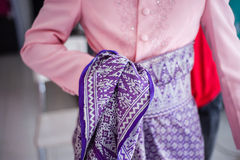 Groom Wearing Songket. View of groom wearing songket Songket is a cloth created by weaving strands of different colours. It is mainly being used as traditional royalty free stock images
