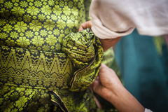 Groom Wearing Songket. View of groom wearing songket Stock Photography