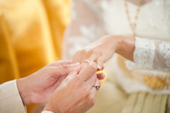 Groom wearing the wedding ring to bride Royalty Free Stock Photo